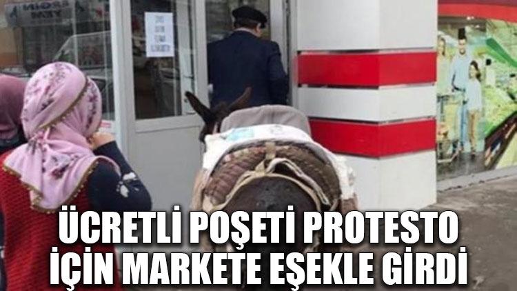 Ücretli poşeti protesto için markete eşekle girdi