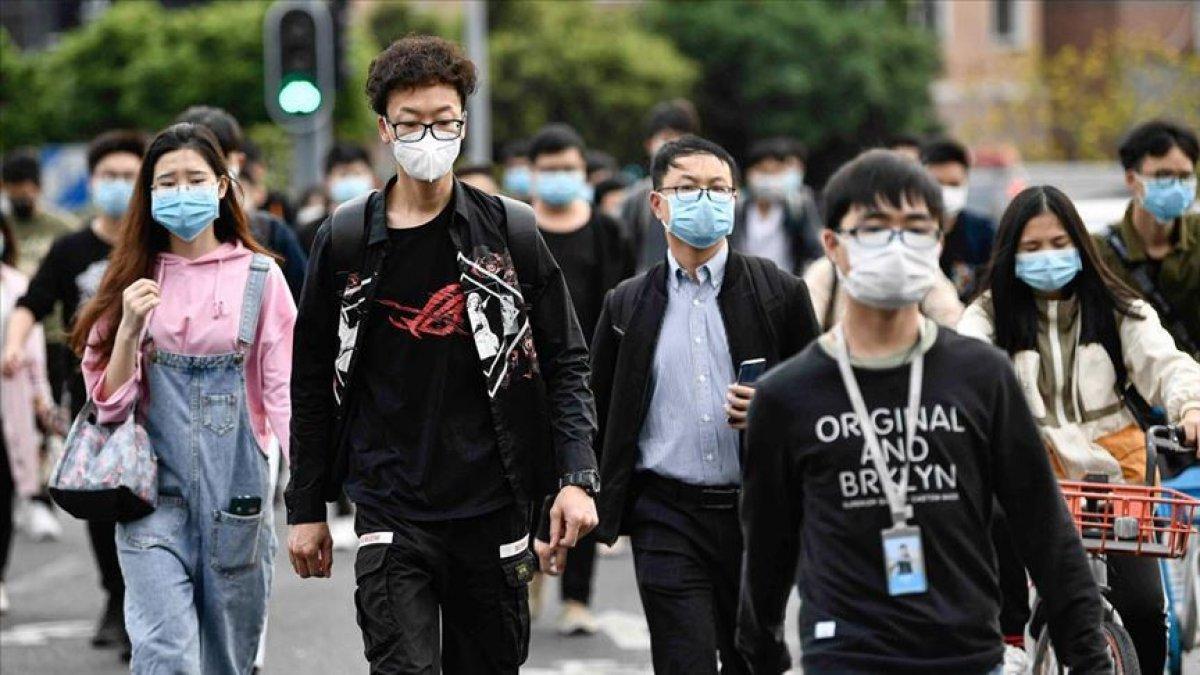 Çinli araştırmacı: En az bir yıl daha maske takılmalı