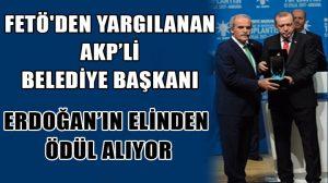 FETÖ'den yargılanan belediye başkanı Erdoğan'ın elinden ödül aldı