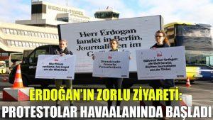 Erdoğan'ın zorlu ziyareti: Protestolar havaalanında başladı